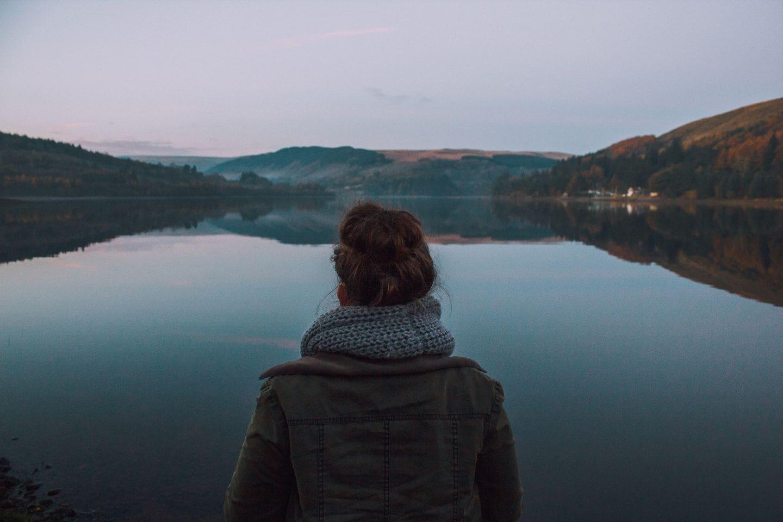 Woman staring at lake