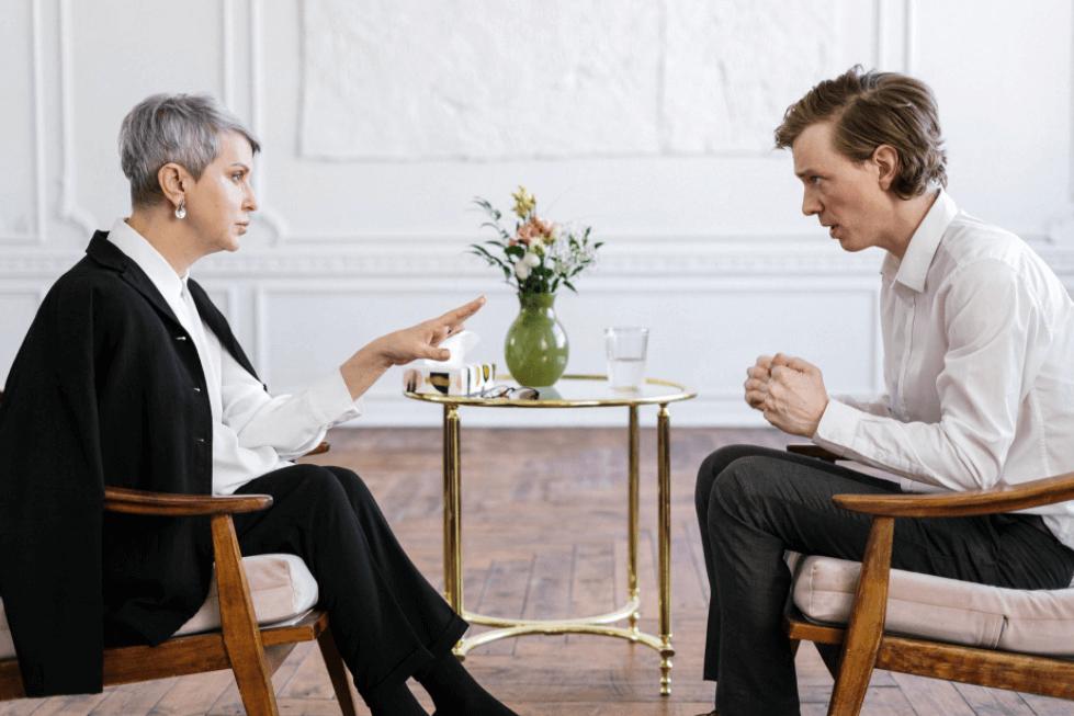 Psychiatrist conversing with patient