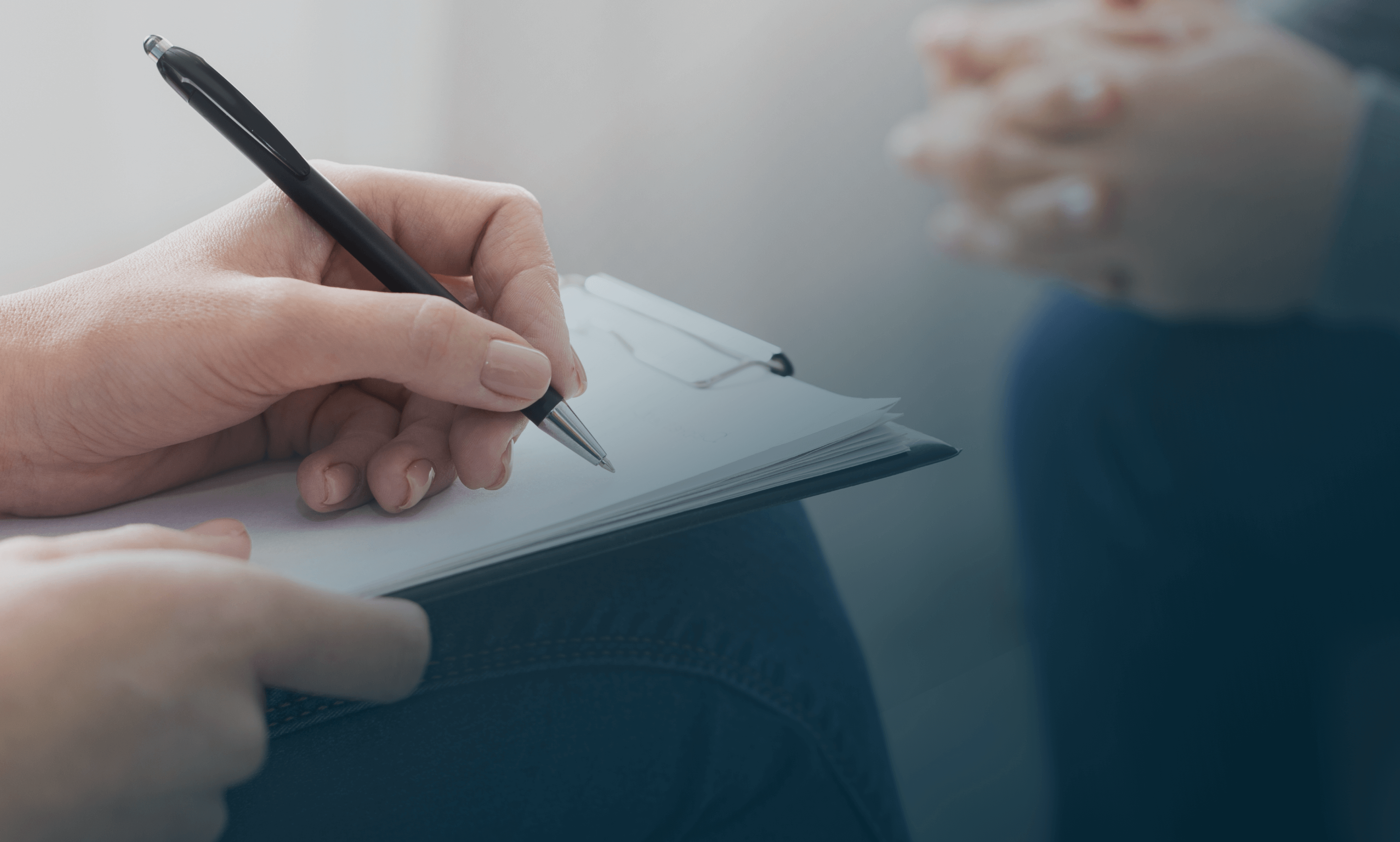 Psychiatrist taking notes on a notepad